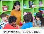 asian female teacher teaching...   Shutterstock . vector #1064731028