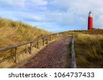 brick road to lighthouse texel... | Shutterstock . vector #1064737433