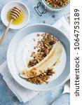 breakfast   yogurt with banana  ...   Shutterstock . vector #1064753189