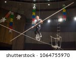 aerial acrobats perform in the... | Shutterstock . vector #1064755970