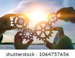 four hands of businessmen... | Shutterstock . vector #1064757656