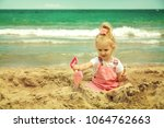baby girl playing in the sand... | Shutterstock . vector #1064762663
