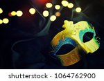 carnival mask background | Shutterstock . vector #1064762900