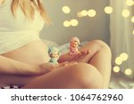 beautiful pregnant woman at home | Shutterstock . vector #1064762960