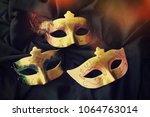 carnival mask background | Shutterstock . vector #1064763014