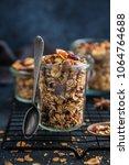 homemade granola  hazelnuts ... | Shutterstock . vector #1064764688