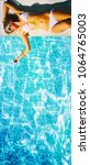 young woman in the swimming pool | Shutterstock . vector #1064765003