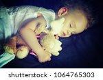 little newborn baby sleeping... | Shutterstock . vector #1064765303