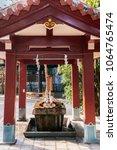 Small photo of Small Temizuya Japanese water ablution pavilion at Naminoue shrine, Naha, Okinawa