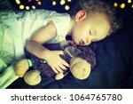 little newborn baby sleeping... | Shutterstock . vector #1064765780