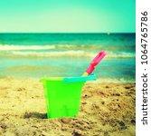 plastic children toys on the... | Shutterstock . vector #1064765786