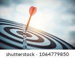 dart arrow hitting in the... | Shutterstock . vector #1064779850