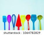 vibrant color kitchen utensils... | Shutterstock . vector #1064782829