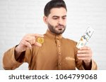 handsome young muslim male... | Shutterstock . vector #1064799068
