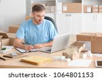 young man with laptop preparing ...   Shutterstock . vector #1064801153