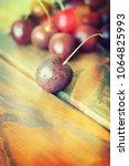 cherries on wooden table    Shutterstock . vector #1064825993