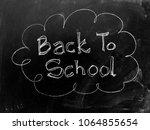 back to school handwritten on... | Shutterstock . vector #1064855654