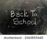 back to school handwritten on... | Shutterstock . vector #1064855660