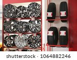 shelves with alloy wheels and... | Shutterstock . vector #1064882246