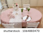 decorated table at home | Shutterstock . vector #1064883470