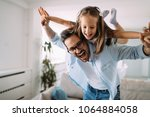 happy family having fun time at ... | Shutterstock . vector #1064884058