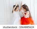 cheerful artistic girls in... | Shutterstock . vector #1064885624