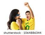 brazilian family cheering... | Shutterstock . vector #1064886344