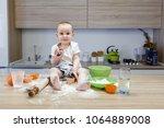 little child sitting on a... | Shutterstock . vector #1064889008