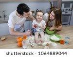 parents prepare breakfast  the... | Shutterstock . vector #1064889044