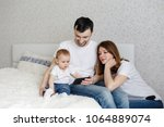 mom and dad and show the phone... | Shutterstock . vector #1064889074