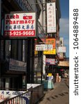 Small photo of Philadelphia, Pennsylvania, USA – August 2, 2016: Vertical shot of the colorful signs in Arch St, Chinatown, Philadelphia, Pennsylvania