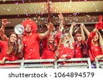 group of fans dressed in red... | Shutterstock . vector #1064894579
