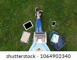 top view of girl sitting in... | Shutterstock . vector #1064902340