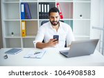 man working at computer in... | Shutterstock . vector #1064908583