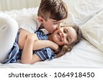 brother and sister having fun... | Shutterstock . vector #1064918450