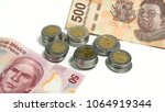 mexican pesos  stacked coins... | Shutterstock . vector #1064919344