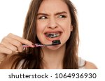 young woman brushing her teeth... | Shutterstock . vector #1064936930