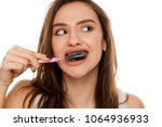 young woman brushing her teeth... | Shutterstock . vector #1064936933