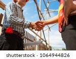 engineer contractor shaking... | Shutterstock . vector #1064944826