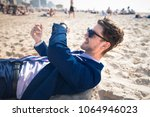 attractive young man in elegant ... | Shutterstock . vector #1064946023