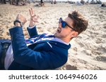 freaky young man in elegant... | Shutterstock . vector #1064946026