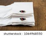 cufflinks with shirt on the... | Shutterstock . vector #1064968550