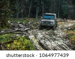 dirty offroad car with dark... | Shutterstock . vector #1064977439