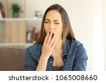 tired woman yawning covering... | Shutterstock . vector #1065008660