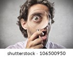 astonished man looking through... | Shutterstock . vector #106500950