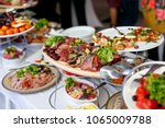 a lot of food and snacks on... | Shutterstock . vector #1065009788