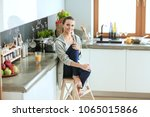 woman in the kitchen. cooking... | Shutterstock . vector #1065015866