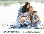 family dad mom and children... | Shutterstock . vector #1065023630