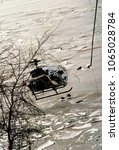 Small photo of Washington, DC., USA, January 14, 1982 A DC Police helicopter hovers over the Potomac River just north of the 14th Street bridge span that AIr Florida #90 hit then plunged into the frozen waters