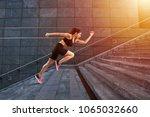 girl runs fast on a modern stair | Shutterstock . vector #1065032660